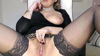 Hot slut  in black stockings with huge boobs  is spreading her pussy